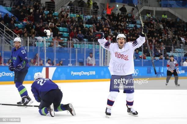 Alexander Bonsaksen of Norway celebrates after scoring the game winning goal against Gasper Kroselj of Slovenia in overtime of the Men's Playoffs...