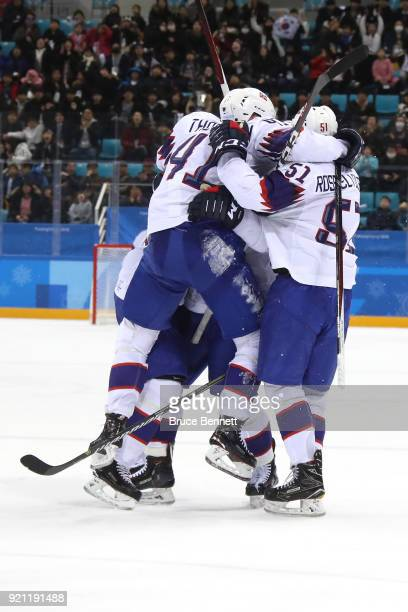 Alexander Bonsaksen of Norway celebrates with his teammates after scoring the game winning goal against Gasper Kroselj of Slovenia in overtime of the...