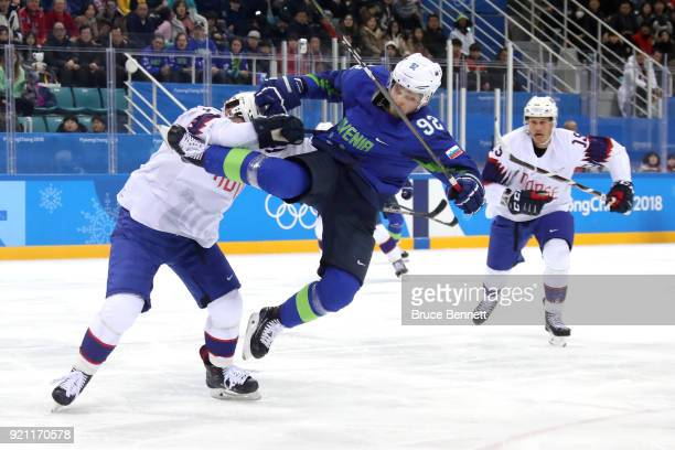 Alexander Bonsaksen of Norway checks Anze Kuralt of Slovenia in the second period during the Men's Playoffs Qualifications game on day eleven of the...