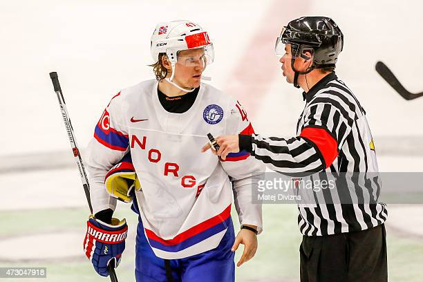 Alexander Bonsaksen of Norway discuss with referee during the IIHF World Championship group B match between Norway and Belarus at CEZ Arena on May 12...