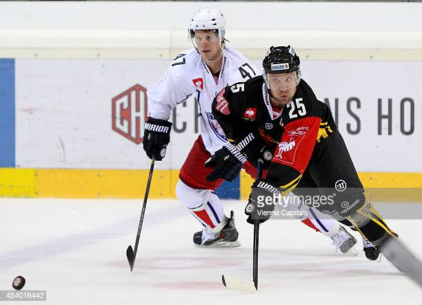 Alexander Bonsaksen of Valerenga and Benoit Gratton of Capitals battle for the puck during the Champions Hockey League group stage game between EV...