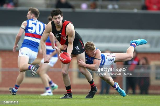 Alexander Boyse of Essendon handballs during the round 20 VFL match between Essendon and Footscray at Windy Hill on August 18 2018 in Melbourne...