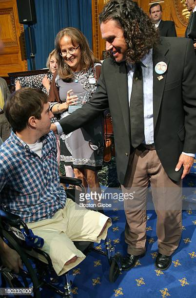 Alexander Brian Carlos Arredondo meets Jeff Bauman Jr seated in wheelchair Bauman was injured during the bombings at the finish line of the Boston...