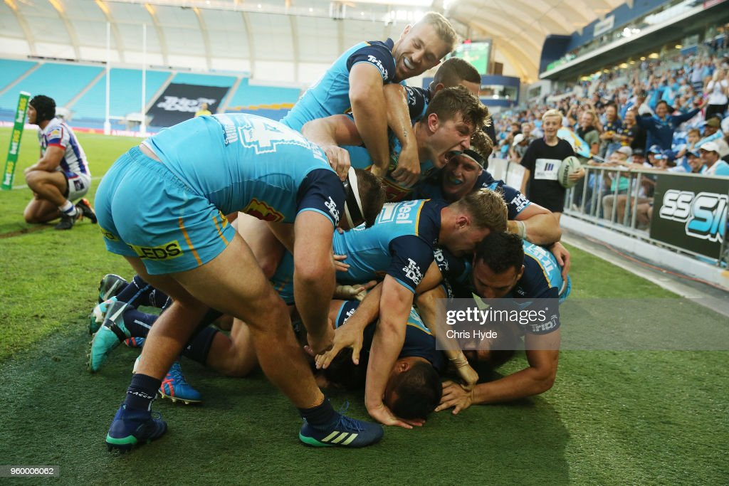 Alexander Brimson of the Titans celebrates a try with team mates during the round 11 NRL match between the Gold Coast Titans and the Newcastle Knights at Cbus Super Stadium on May 19, 2018 in Gold Coast, Australia.