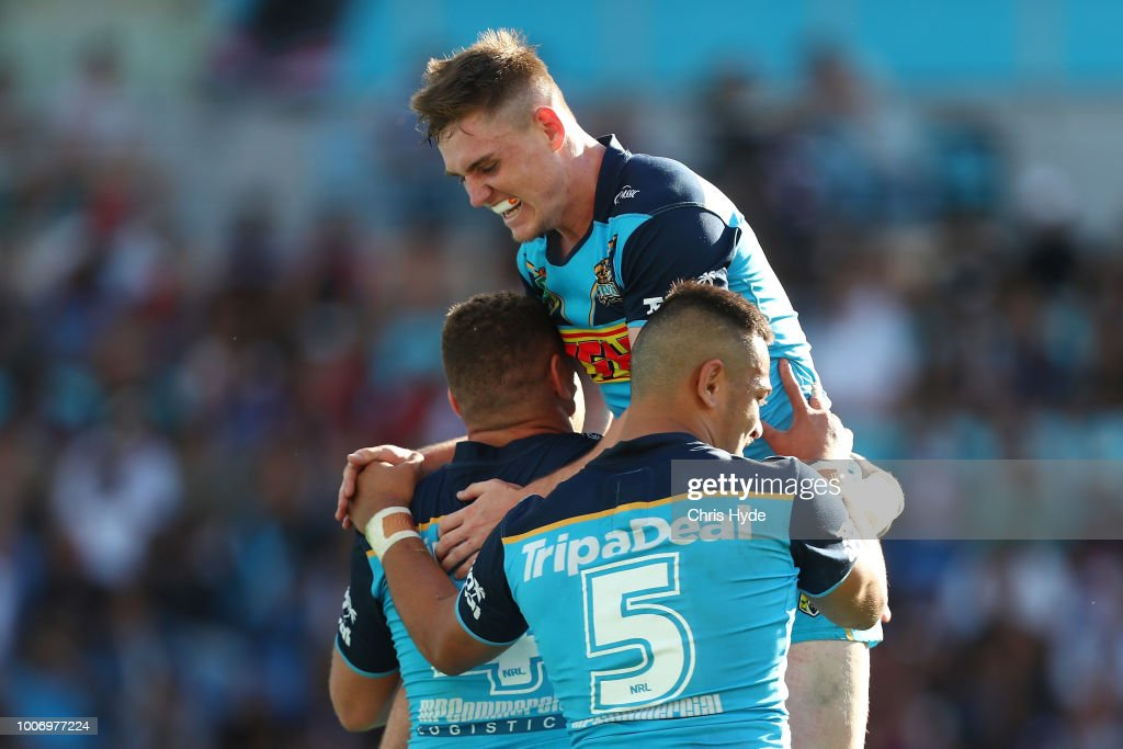 Alexander Brimson of the Titans jumps as team mate Brenko Lee celebrates a try during the round 20 NRL match between the Gold Coast Titans and the New Zealand Warriors at Cbus Super Stadium on July 29, 2018 in Gold Coast, Australia.
