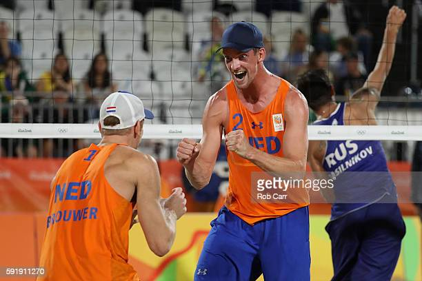 Alexander Brouwer and Robert Meeuwsen of Netherlands celebrate winning the Men's Beach Volleyball Bronze medal match against Viacheslav Krasilnikov...