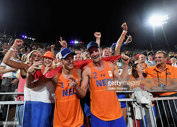 Alexander Brouwer and Robert Meeuwsen of Netherlands celebrate with fans winning the Men's Beach Volleyball Bronze medal match against Viacheslav...