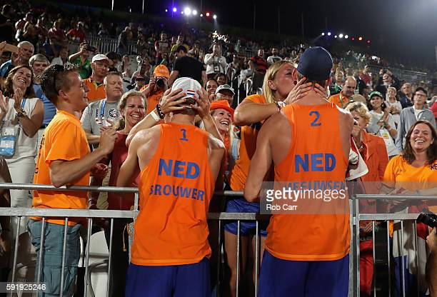 Alexander Brouwer and Robert Meeuwsen of the Netherlands celebrate with the fans winning the Men's Beach Volleyball Bronze medal match against...