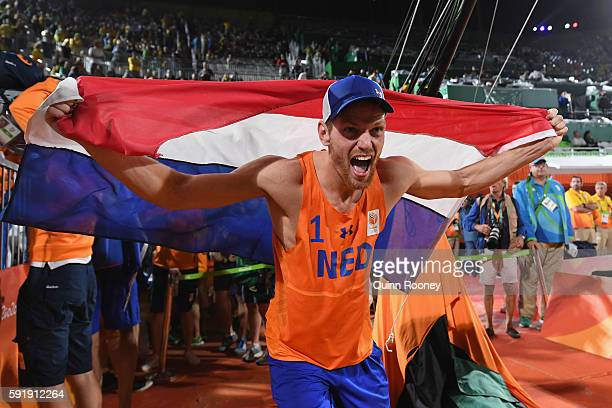 Alexander Brouwer of Netherlands celebrates winning the Men's Beach Volleyball Bronze medal match against Viacheslav Krasilnikov and Konstantin...