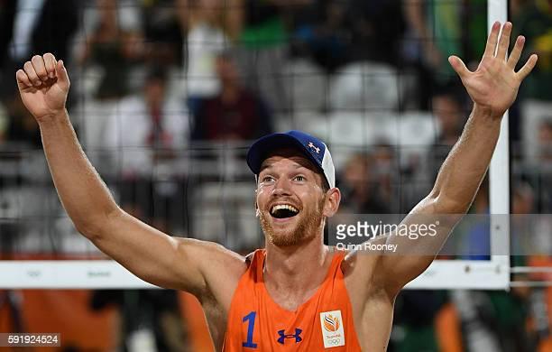Alexander Brouwer of Netherlands celebrates winning the Men's Beach Volleyball Bronze medal match against Viacheslav Krasilnikov and Konstantin...