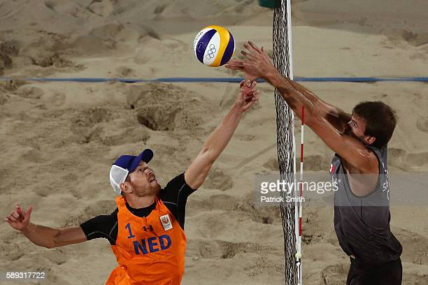 Alexander Brouwer of Netherlands vies for the ball against Ben Saxton of Canada during a Men's Round of 16 match between Canada and Netherlands on...