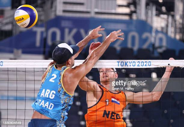 Alexander Brouwer of Team Netherlands competes against Julian Amado Azaad of Team Argentina during the Men's Preliminary - Pool D beach volleyball on...