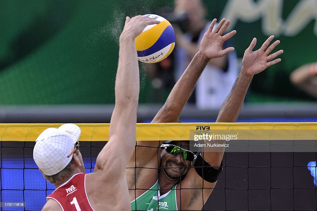 Alexander Brouwer (L) of the Netherlands attacks against Ricardo Alex Costa Santos (R) of Brazil during the men's final match between the Netherlands and Brazil during Day 7 of the FIVB World Championships on July 7, 2013 in Stare Jablonki, Poland.