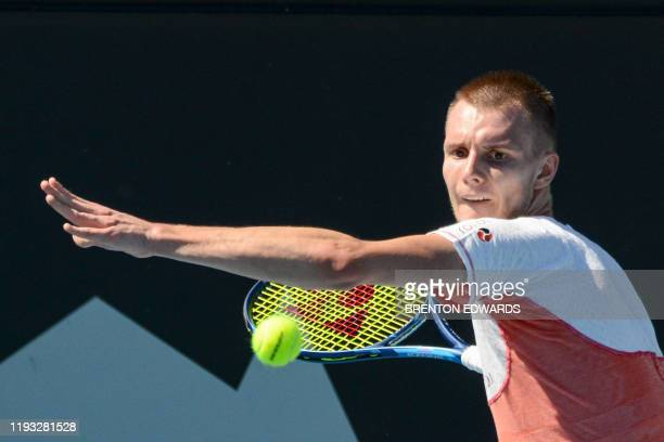 Alexander Bublik of Kazakhstan hits a return against Taylor Fritz of the US during their first session men's singles match on day one of the ATP Cup...