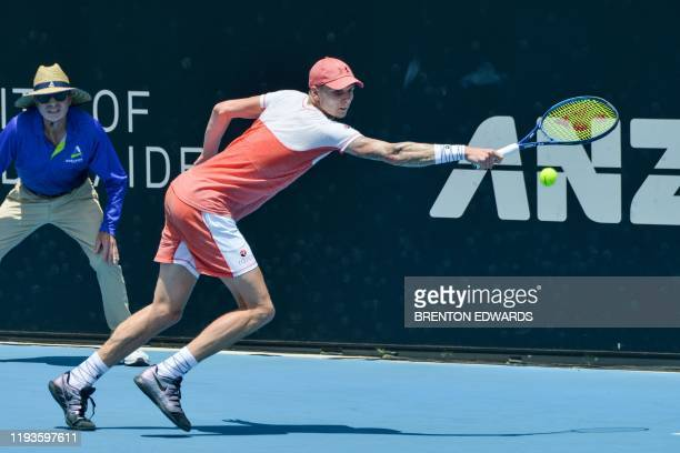 Alexander Bublik of Kazakhstan hits a return to Daniel Evans of Britain during their men's second round singles match at the Adelaide International...