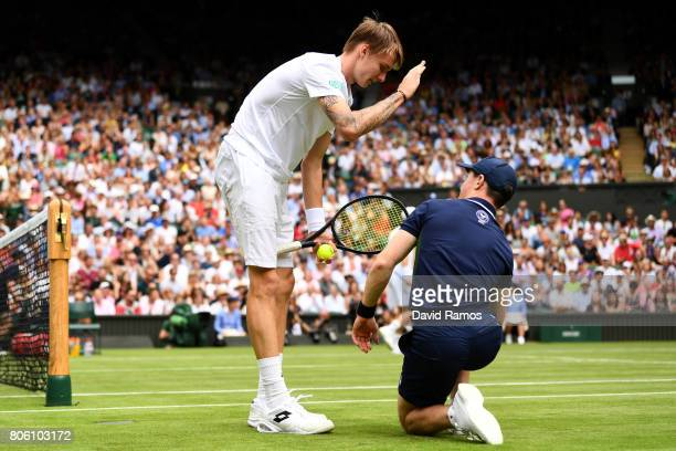 Alexander Bublik of Kazakhstan jokes with a ball boy during the Gentlemen's Singles first round match against Andy Murray of Great Britain on day one...