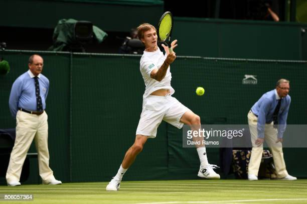 Alexander Bublik of Kazakhstan plays a forehand during the Gentlemen's Singles first round match against Andy Murray of Great Britain on day one of...