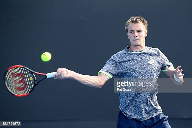Alexander Bublik of Kazakhstan plays a forehand in his first round match against Lucas Pouille of France on day one of the 2017 Australian Open at...