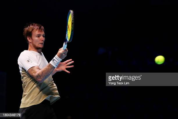 Alexander Bublik of Kazakhstan plays a forehand in his Men's Singles Semifinal match against Radu Albot of Moldova on day six of the Singapore Tennis...