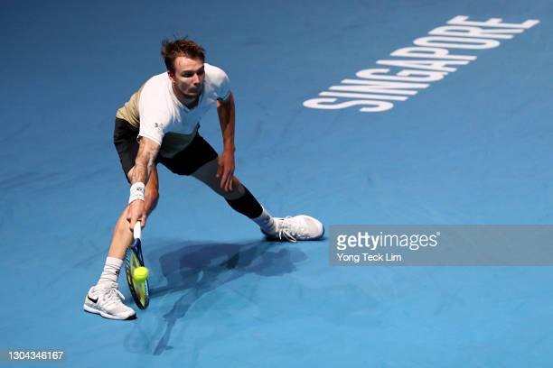 Alexander Bublik of Kazakhstan stretches for a forehand in his Men's Singles Semifinal match against Radu Albot of Moldova on day six of the...