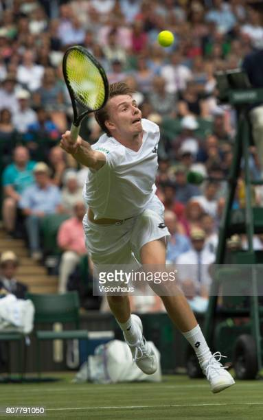 Alexander Bublik of Kazakstan in action against Andy Murray of Great Britain during the Wimbledon Lawn Tennis Championships at the All England Lawn...