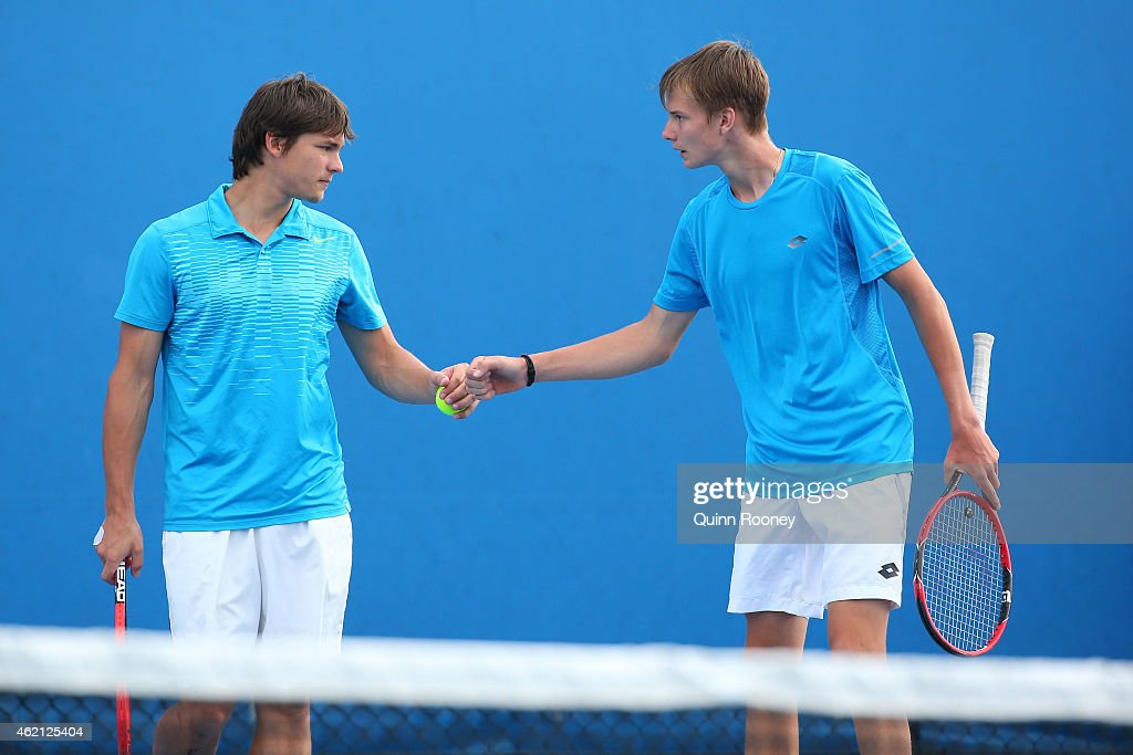 Alexander Bublik of Russia and Boris Pokotilov of Russia in action in their match against Miomir Kecmanovic of Serbia and Michael Mmoh of the United States during the Australian Open 2015 Junior Championships at Melbourne Park on January 25, 2015 in Melbourne, Australia.