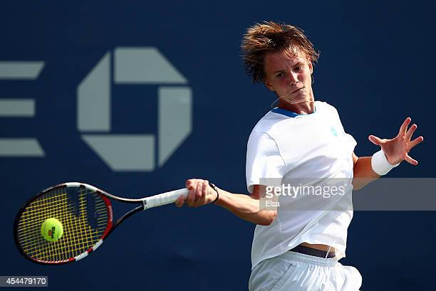 Alexander Bublik of Russia plays against Naoki Nakagawa of Japan in their junior boys' first round match on Day Eight of the 2014 US Open at the USTA...