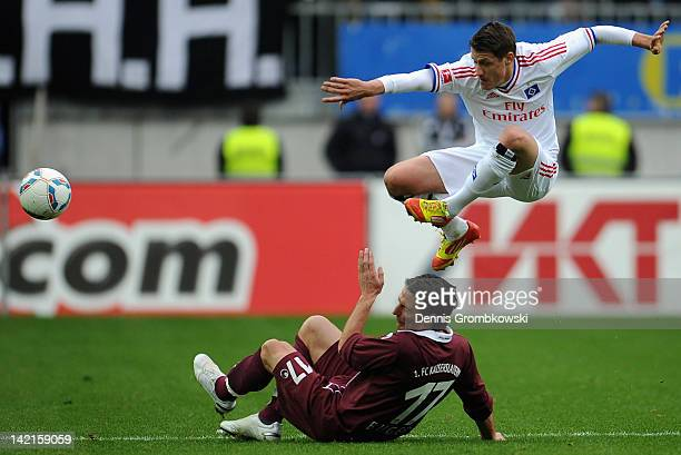 Alexander Bugera of Kaiserslautern challenges Ivo Ilicevic of Hamburg during the Bundesliga match between 1 FC Kaiserslautern and Hamburger SV at...