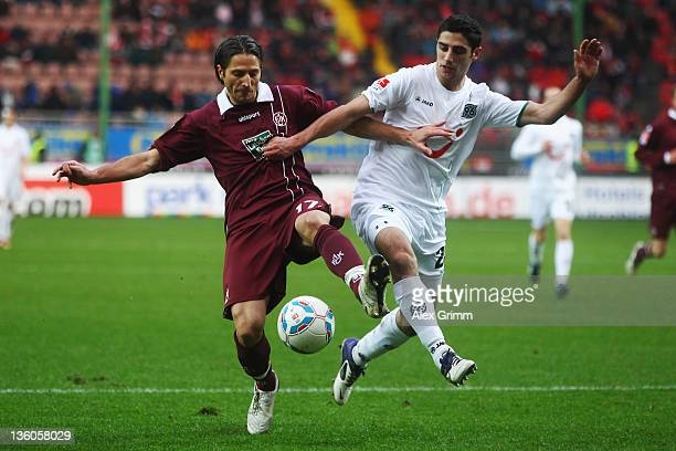 Alexander Bugera of Kaiserslautern is challenged by Lars Stindl of Hannover during the Bundesliga match between 1. FC Kaiserslautern and Hannover 96...