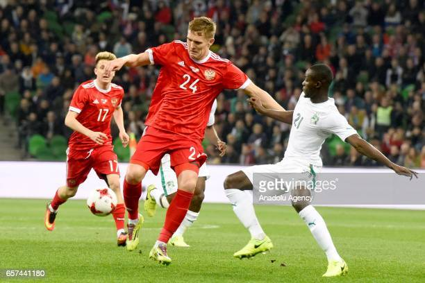 Alexander Bukharov of Russia in action against player of Cote d'Ivoire's during the friendly football match at Krasnodar Stadium in Krasnodar Russia...
