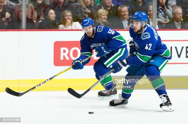 Alexander Burmistrov and Alex Biega of the Vancouver Canucks skate up ice during their NHL game against the Washington Capitals at Rogers Arena...
