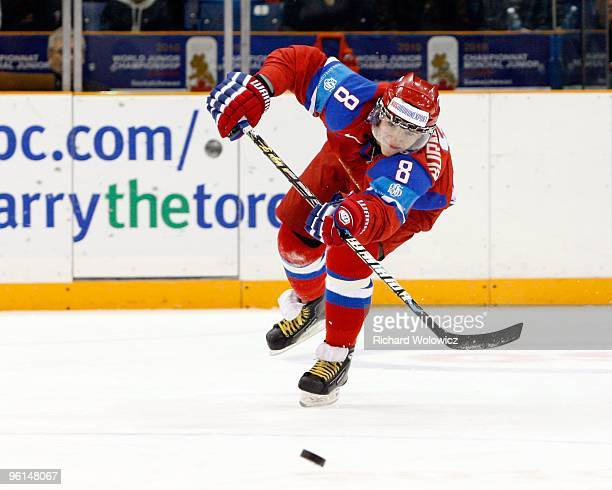 Alexander Burmistrov of Team Russia passes the puck during the 2010 IIHF World Junior Championship Tournament Fifth Place game against Team Finland...