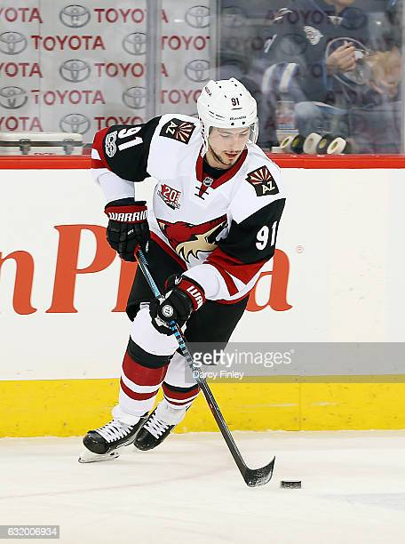 Alexander Burmistrov of the Arizona Coyotes takes part in the pregame warm up prior to NHL action against the Winnipeg Jets at the MTS Centre on...