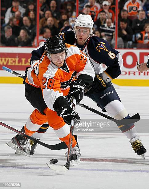 Alexander Burmistrov of the Atlanta Thrashers battles for the puck against Claude Giroux of the Philadelphia Flyers during the first period on March...