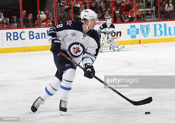 Alexander Burmistrov of the Winnipeg Jets caries the puck during an NHL game against the Carolina Hurricanes on November 25 2011 at RBC Center in...