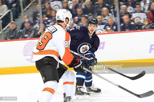 Alexander Burmistrov of the Winnipeg Jets follows the play down the ice as Sam Gagner of the Philadelphia Flyers defends during thirdperiod action at...