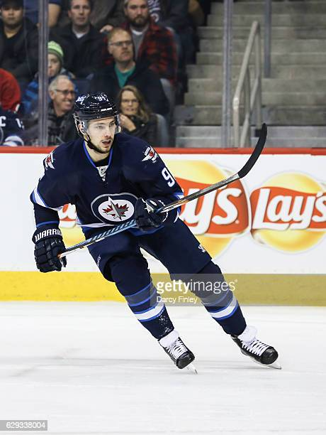 Alexander Burmistrov of the Winnipeg Jets follows the play up the ice during first period action against the Detroit Red Wings at the MTS Centre on...