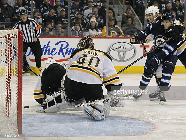 Alexander Burmistrov of the Winnipeg Jets scores against Tuukka Rask of the Boston Bruins during second period action on February 17, 2013 at the MTS...