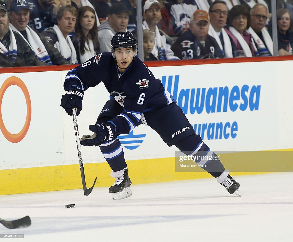 Alexander Burmistrov #6 of the Winnipeg Jets skates down the ice during second period action in an NHL game against the Minnesota Wild at the MTS Centre on October 25, 2015 in Winnipeg, Manitoba, Canada.