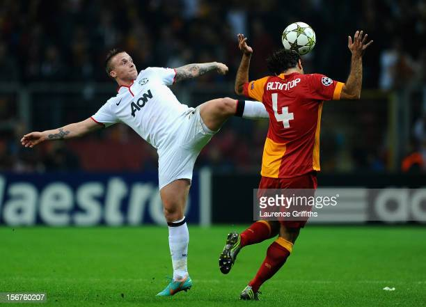 Alexander Buttner of Manchester United battles with Hamit Altintop of Galatasary during the UEFA Champions League Group H match between Galatasaray...