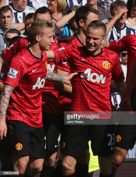 Alexander Buttner of Manchester United celebrates scoring their third goal during the Barclays Premier League match between Wet Bromwich Albion and...