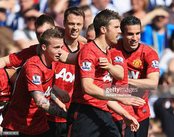 Alexander Buttner of Manchester United celebrates with team mates as he scores their third goal during the Barclays Premier League match between West...