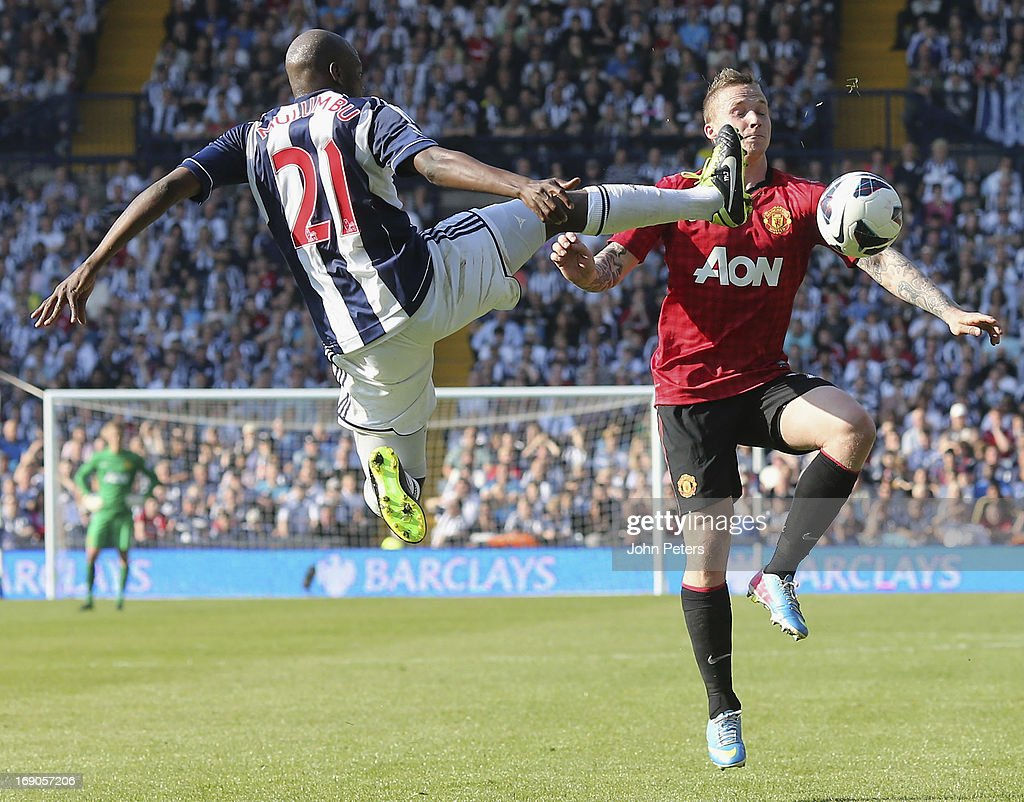 Alexander Buttner of Manchester United in action with Yossouf Mulumbu of West Bromwich Albion during the Barclays Premier League match between Wet Bromwich Albion and Manchester United at The Hawthorns on May 19, 2013 in West Bromwich, England.