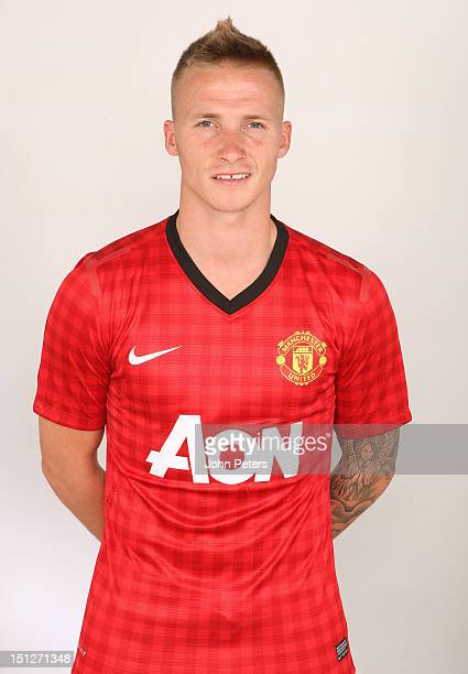 Alexander Buttner of Manchester United poses during a photocall at Carrington Training Ground on August 21 2012 in Manchester England
