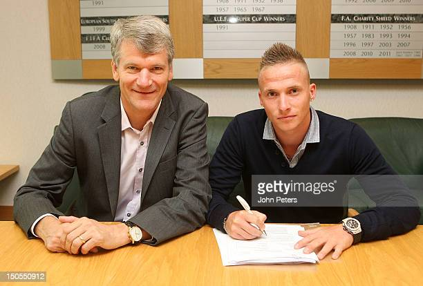 Alexander Buttner of Manchester United poses with Chief Executive David Gill after signing with the club at Old Trafford on August 21 2012 in...