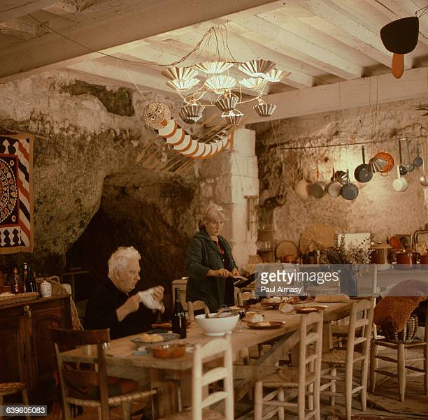 Alexander Calder and his wife Louisa eating dinner in their kitchen in an old farmhouse Sache France ca 19501976