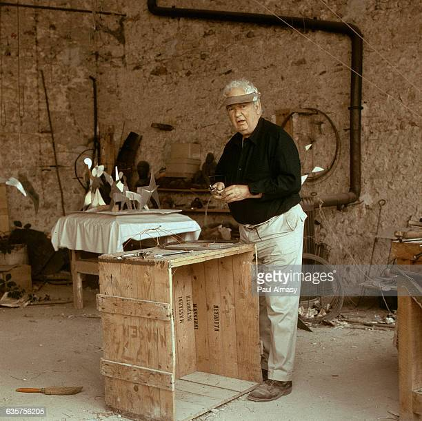 Alexander Calder at work in his studio in Sache France ca 1960s