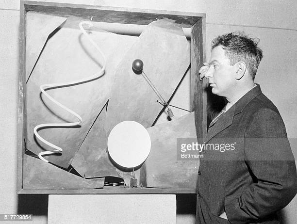 Alexander Calder sculptor who devised the 'mobiles' a new artistic medium which is causing considerable discussion in art circles with one of his...
