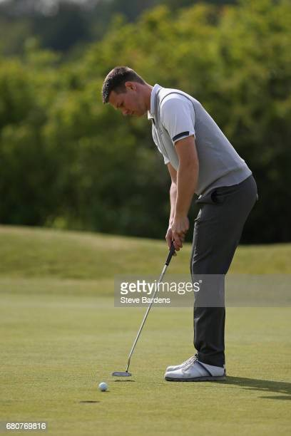 Alexander Caldicott putts during the PGA Assistants Championship South Qualifier at Farleigh golf club on May 9 2017 in Warlingham England