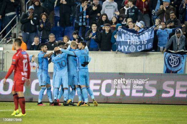 Alexander Callens of New York City celebrates his goal with teammates during the Scotiabank CONCACAF Champions League 2nd Leg Match between New York...